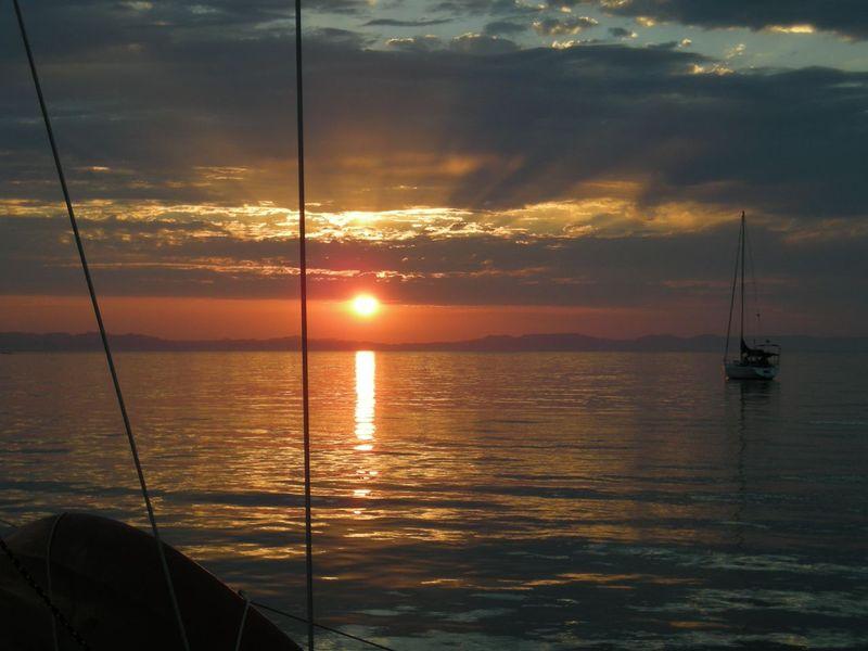 Sail, sunset on water